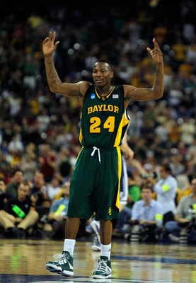 HOUSTON - MARCH 28: LaceDarius Dunn #24 of the Baylor Bears encourages the crowd against the Duke Blue Devils during the south regional final of the 2010 NCAA men's basketball tournament at Reliant Stadium on March 28, 2010 in Houston, Texas. Duke defeate