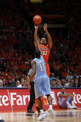CHAMPAIGN, IL - NOVEMBER 30: Demetri McCamey #32 of the Illinois Fighting Illini takes a shot over Larry Drew II #11 of the North Carolina Tar Heels during first half action of the 2010 ACC/Big Ten Challenge at Assembly Hall on November 30, 2010 in Champa