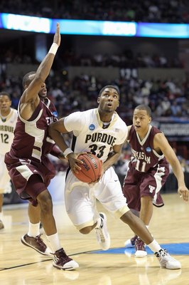 SPOKANE,WA - MARCH 21: E'Twaun Moore #33 of the Purdue Boilermakers drives the ball against the Texas A&M Aggies during the second round of the 2010 NCAA men's basketball tournament at the Spokane Arena on March 21, 2010 in Spokane, Washington. Purdue def