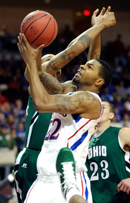LAS VEGAS - NOVEMBER 26:  Marcus Morris #22 of the Kansas Jayhawks shoots against Asown Sayles #44 of the Ohio Bobcats during the third round of the Las Vegas Invitational at The Orleans Arena November 26, 2010 in Las Vegas, Nevada. Kansas won 98-41.  (Ph