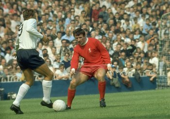 Undated:  Martin Chivers of Tottenham Hotspur takes on Tommy Smith of Liverpool during a match at Anfield in Liverpool, England. \ Mandatory Credit: Allsport UK /Allsport
