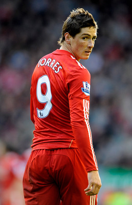 LIVERPOOL, ENGLAND - OCTOBER 24:   Fernando Torres of Liverpool looks on during the Barclays Premier League match between Liverpool and Blackburn Rovers at Anfield on October 24, 2010 in Liverpool, England. (Photo by Michael Regan/Getty Images)