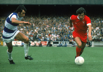 LONDON - AUGUST 16:  Kevin Keegan of Liverpool looks to take the ball past Dave Clement of Queens Park Rangers during the League Division One match held on August 16, 1975 at Loftus Road, in London. Queens Park Rangers won the match 2-0. (Photo by Don Mor