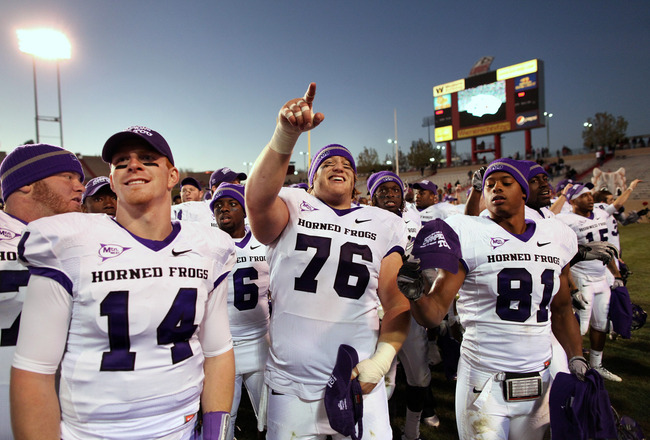 ALBUQUERQUE, NM - NOVEMBER 27: TCU Horned Frogs quarterback Andy Dalton #14, center Jake Kirkpatrick #76 and wide receiver Alonzo Adams #81 celebrate their 66-17 win over the University of New Mexico Lobos on November 27, 2010 at University Stadium in Alb