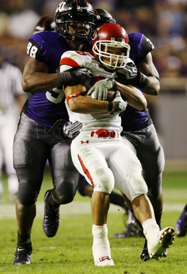 FORT WORTH, TX - NOVEMBER 14:  Eddie Wide #36 of the Utah Utes is tackled by Jerry Hughes #98 of the TCU Horned Frogs during the second half of the game at Amon G. Carter Stadium on November 14, 2009 in Fort Worth, Texas. TCU won the game 55-28. (Photo by
