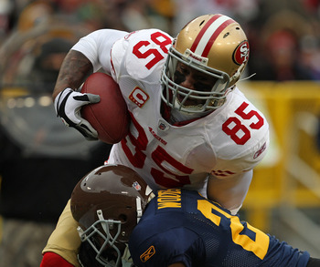 GREEN BAY, WI - DECEMBER 05: Vernon Davis #85 of the San Francisco 49ers is hit by Chales Woodson #21 of the Green Bay Packers at Lambeau Field on December 5, 2010 in Green Bay, Wisconsin. (Photo by Jonathan Daniel/Getty Images)