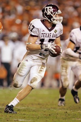 AUSTIN, TX - NOVEMBER 27: Quarterback  Ryan Tannehill #17 of the Texas A&M Aggies runs the ball against the Texas Longhorns on November 27, 2008 at Darrell K Royal-Texas Memorial Stadium in Austin, Texas.  Texas won 49-9. (Photo by Brian Bahr/Getty Images