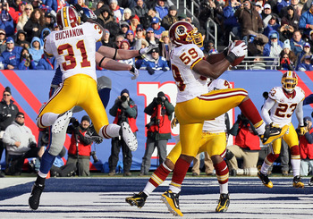 EAST RUTHERFORD, NJ - DECEMBER 05:  London Fletcher #59 of the Washington Redskins intercepts a pass in the endzone intended for Kevin Boss #89 of the New York Giants on December 5, 2010 at the New Meadowlands Stadium in East Rutherford, New Jersey.  (Pho