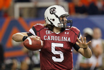 ATLANTA, GA - DECEMBER 04:  Stephen Garcia #5 of the South Carolina Gamecocks looks to pass against the Auburn Tigers during the 2010 SEC Championship at Georgia Dome on December 4, 2010 in Atlanta, Georgia.  (Photo by Kevin C. Cox/Getty Images)