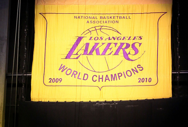 LOS ANGELES, CA - OCTOBER 26:  The 2009-2010 Los Angeles Lakers Championship Banner is unveiled during a ceremony prior to their opening night game against the Houston Rockets at Staples Center on October 26, 2010 in Los Angeles, California. NOTE TO USER: