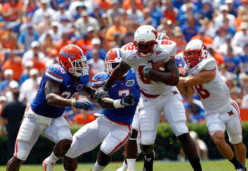GAINESVILLE, FL - SEPTEMBER 04:  Kendrick Bruton #82 of the Miami University RedHawks breaks the tackle of Ronald Powell #7 of the Florida Gators at Ben Hill Griffin Stadium on September 4, 2010 in Gainesville, Florida.  (Photo by Sam Greenwood/Getty Imag