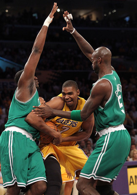 LOS ANGELES, CA - JUNE 15:  Andrew Bynum #17 of the Los Angeles Lakers drives through Kendrick Perkins #43 and Kevin Garnett #5 of the Boston Celtics in the first period of Game Six of the 2010 NBA Finals at Staples Center on June 15, 2010 in Los Angeles,