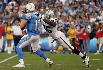 SAN DIEGO - DECEMBER 05:  Quarterback Philip Rivers #17 of the San Diego Chargers is sacked by Kamerion Wimbley #96 of the Oakland Raiders at Qualcomm Stadium on December 5, 2010 in San Diego, California. The Raiders defeated the Chargers 28-13.  (Photo b