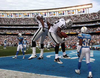 SAN DIEGO, CA - DECEMBER 5:  Wide Receiver Jacoby Ford #12 and Darius Heyward-Bey #85 of the Oakland Raiders celebrate Ford's touchdown catch in front of Donald Strickland #30 of the San Diego Chargers a during their NFL game at Qualcomm Stadium on Decemb