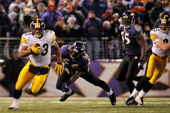 BALTIMORE, MD - DECEMBER 05:  Running back Isaac Redman #33 of the Pittsburgh Steelers runs the ball against linebacker Tavares Gooden #56 of the Baltimore Ravens during the second quarter of the game at M&T Bank Stadium on December 5, 2010 in Baltimore,
