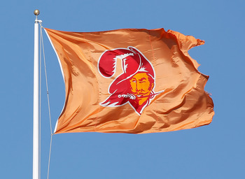 TAMPA, FL - DECEMBER 05:  A 'throwback Bucco Bruce Flag' of the Tampa Bay Buccaneers flies over Raymond James Stadium just before the start of the game against the Atlanta Falcons on December 5, 2010 in Tampa, Florida.  (Photo by J. Meric/Getty Images)