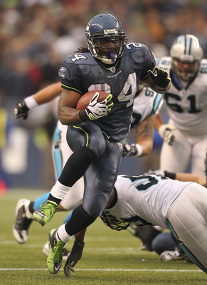 SEATTLE, WA - DECEMBER 05:  Running back Marshawn Lynch #24 of the Seattle Seahawks rushes for a touchdown in the fourth quarter against the Carolina Panthers at Qwest Field on December 5, 2010 in Seattle, Washington. The Seahawks defeated the Panthers 31