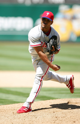OAKLAND, CA - JUNE 19:  Ugueth Urbina #74 of the Philadelphia Phillies pitches against the Oakland Athletics during their interleague MLB game at McAfee Coliseum on June 19, 2005 in Oakland, California.  The Athletics defeated the Phillies 5-2. (Photo by