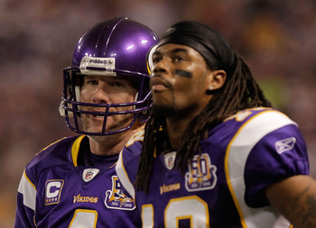MINNEAPOLIS, MN - DECEMBER 05:  Brett Favre #4 of the Minnesota Vikings talks with Sidney Rice #18 on the sideline during the game against the Buffalo Bills at the Mall of America Field at the Hubert H. Humphrey Metrodome on December 5, 2010 in Minneapoli
