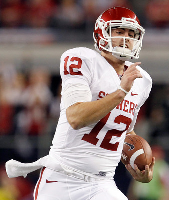 ARLINGTON, TX - DECEMBER 04:  Quarterback Landry Jones #12 of the Oklahoma Sooners carries the ball against the Nebraska Cornhuskers at Cowboys Stadium on December 4, 2010 in Arlington, Texas.  The Sooners beat the Cornhuskers 23-20.  (Photo by Tom Pennin