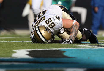 CHARLOTTE, NC - NOVEMBER 07:  Jeremy Shockey #88 of the New Orleans Saints is injured after a touchdown against the Carolina Panthers during their game at Bank of America Stadium on November 7, 2010 in Charlotte, North Carolina.  (Photo by Streeter Lecka/