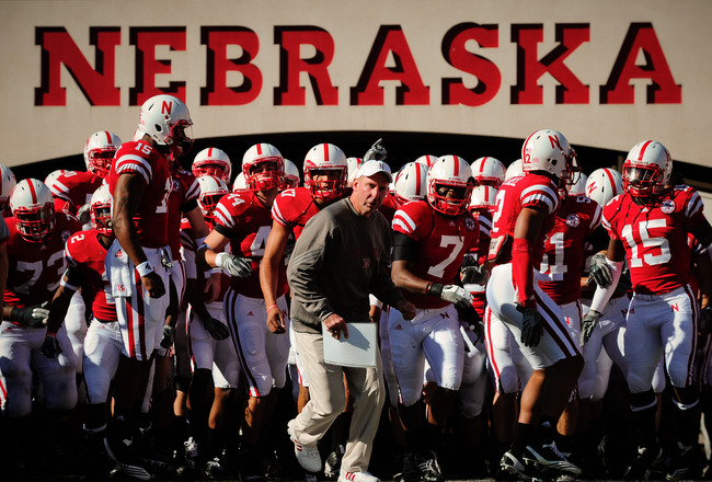 LINCOLN, NE - OCTOBER 30: Coach Bo Pelini  leads his Nebraska Cornhusker football team on the field against the Missouri Tigers at Memorial Stadium on October 30, 2010 in Lincoln, Nebraska. Nebraska Defeated Missouri 31-17. (Photo by Eric Francis/Getty Im