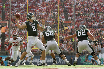 ORLANDO, FL - JANUARY 01:  Kirk Cousins #8 of the Michigan State Spartans passes the ball during the Capitol One Bowl against the Alabama Crimson Tide at the Florida Citrus Bowl on January 1, 2011 in Orlando, Florida.  (Photo by Mike Ehrmann/Getty Images)