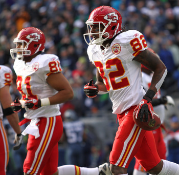 SEATTLE, WA - NOVEMBER 28:  Wide receiver Dwayne Bowe #82 of the Kansas City Chiefs heads back to the team bench after scoring his first touchdown against Kelly Jennings #21 of the Seattle Seahawks at Qwest Field on November 28, 2010 in Seattle, Washingto
