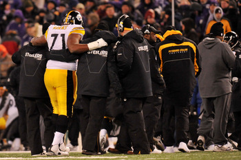 BALTIMORE, MD - DECEMBER 05:  Tackle Flozell Adams #71 of the Pittsburgh Steelers is helped off the field after an injury during the third quarter of the game against the Baltimore Ravens at M&T Bank Stadium on December 5, 2010 in Baltimore, Maryland.  (P