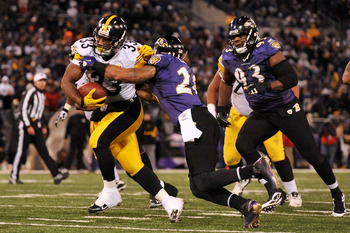 BALTIMORE, MD - DECEMBER 05:  Running back Isaac Redman #33 of the Pittsburgh Steelers runs the ball in for a touchdown against safety Dawan Landry #26 of the Baltimore Ravens during the fourth quarter of the game at M&T Bank Stadium on December 5, 2010 i