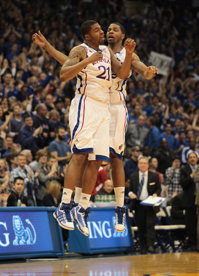 LAWRENCE, KS - DECEMBER 02:  Marcus Morris #22 and Markieff Morris #21 of the Kansas Jayhawks celebrate after a basket during the game against the UCLA Bruins on December 2, 2010 at Allen Fieldhouse in Lawrence, Kansas.  (Photo by Jamie Squire/Getty Image