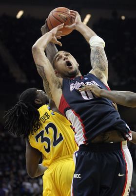 KANSAS CITY, MO - NOVEMBER 23:  Robert Sacre #00 of the Gonzaga Bulldogs grabs a rebound over Jae Crowder #32 of the Marquette Golden Eagles during the CBE Classic consolation game on November 23, 2010 at the Sprint Center in Kansas City, Missouri.  (Phot