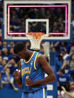 LAWRENCE, KS - DECEMBER 02:  Anthony Stover #0 of the UCLA Bruins reacts as he walks off the court after the Kansas Jayhawks defeated the Bruins with a final score of 77-76 to win the game on December 2, 2010 at Allen Fieldhouse in Lawrence, Kansas.  (Pho