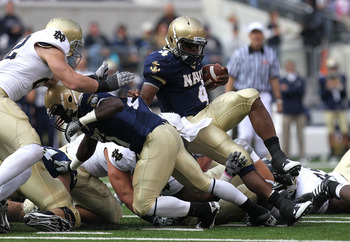 EAST RUTHERFORD, NJ - OCTOBER 23:  Ricky Dobbs #4 of Navy is tackled against Notre Dame at New Meadowlands Stadium on October 23, 2010 in East Rutherford, New Jersey.  (Photo by Nick Laham/Getty Images)