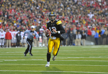 IOWA CITY, IA - NOVEMBER 20:  Quarterback Ricky Stanzi #12 of the University of Iowa Hawkeyes scrambles for yards under pressure from the Ohio State Buckeyes at Kinnick Stadium on November 20, 2010 in Iowa City, Iowa. Ohio State won 20-17 over Iowa. (Phot
