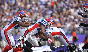 BALTIMORE, MD - OCTOBER 24:  Donte Whitner #20 of the Buffalo Bills runs the ball against the Baltimore Ravens at M&T Bank Stadium on October 24, 2010 in Baltimore, Maryland. The Ravens defeated the Bills 37-34. (Photo by Larry French/Getty Images)