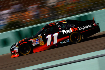 HOMESTEAD, FL - NOVEMBER 21:  Denny Hamlin, driver of the #11 FedEx Toyota, races during the NASCAR Sprint Cup Series Ford 400 at Homestead-Miami Speedway on November 21, 2010 in Homestead, Florida.  (Photo by Jason Smith/Getty Images for NASCAR)