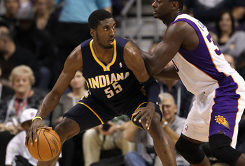 PHOENIX - DECEMBER 03:  Roy Hibbert #55 of the Indiana Pacers handles the ball during the NBA game against the Phoenix Suns at US Airways Center on December 3, 2010 in Phoenix, Arizona.  The Suns defeated the Pacers 105-97.  NOTE TO USER: User expressly a