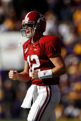 BATON ROUGE, LA - NOVEMBER 06:  Quarterback Greg McElroy #12 of the Alabama Crimson Tide celebrates after scoring against the Louisiana State University Tigers at Tiger Stadium on November 6, 2010 in Baton Rouge, Louisiana.  (Photo by Chris Graythen/Getty