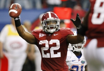 ATLANTA - DECEMBER 5:  Mark Ingram #22 of the Alabama Crimson Tide celebrates after he scored a 7-yard rushing touchdown in the first quarter against the Florida Gators during the SEC Championship game at Georgia Dome on December 5, 2009 in Atlanta, Georg