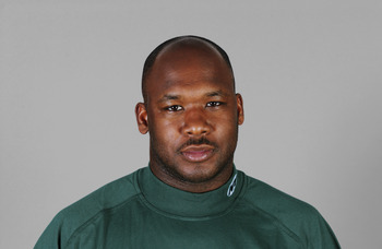 EAST RUTHERFORD, NJ - 2005:  Corwin Brown of the New York Jets poses for his 2005 NFL headshot at photo day in East Rutherford, New Jersey.  (Photo by Getty Images)