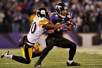 BALTIMORE, MD - DECEMBER 05:  T.J. Houshmandzadeh #84 of the Baltimore Ravens runs the ball against Bryant McFadden #20 of the Pittsburgh Steelers during the first half of the game at M&amp;T Bank Stadium on December 5, 2010 in Baltimore, Maryland. Pittsburgh