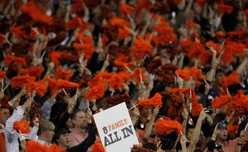 ATLANTA, GA - DECEMBER 04:  Fans of the Auburn Tigers cheer against the South Carolina Gamecocks during the 2010 SEC Championship at Georgia Dome on December 4, 2010 in Atlanta, Georgia.  (Photo by Kevin C. Cox/Getty Images)