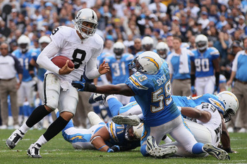 SAN DIEGO - DECEMBER 05:  Quarterback Jason Campbell #8 the Oakland Raiders breaks the tackle of Brandon Siler #59 of the San Diego Chargers in the second quarter at Qualcomm Stadium on December 5, 2010 in San Diego, California. The Raiders defeated the C