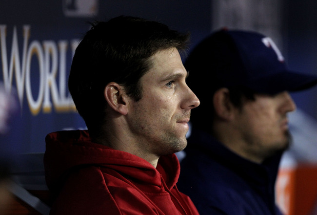 ARLINGTON, TX - NOVEMBER 01:  Losing pitcher Cliff Lee #33 of the Texas Rangers looks on from the dugout against the San Francisco Giants in Game Five of the 2010 MLB World Series at Rangers Ballpark in Arlington on November 1, 2010 in Arlington, Texas.