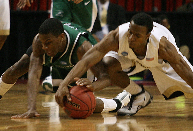 MIAMI - MARCH 20:  Guard  Norris Cole #30 (L) of the Cleveland State University Vikings fights for a loose ball against guard  Ishmael Smith #10 (R) of Wake Forest Demon Deacons during the first round of the NCAA Division I Men's Basketball Tournament at