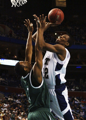 BUFFALO, NY - MARCH 15:  Antonio Graves #22 of the Pittsburgh Panthers goes to the hoop against Scottie Wilson #2 of the Wright State Raiders during round one of the NCAA Men's Basketball Tournament at the HSBC Arena on March 15, 2007  in Buffalo, New Yor