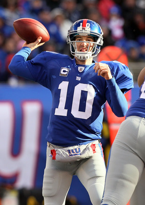 EAST RUTHERFORD, NJ - DECEMBER 05:  Eli Manning #10 of the New York Giants throws a pass against the Washington Redskins on December 5, 2010 at the New Meadowlands Stadium in East Rutherford, New Jersey.  (Photo by Jim McIsaac/Getty Images)