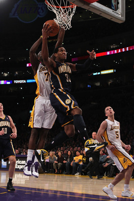 LOS ANGELES, CA - NOVEMBER 28:  Danny Granger #33 of the Indiana Pacers drives to the basket past  Lamar Odom #7 of the Los Angeles Lakers during the fourth quarter at Staples Center on November 28, 2010 in Los Angeles, California. The Pacers defeated the
