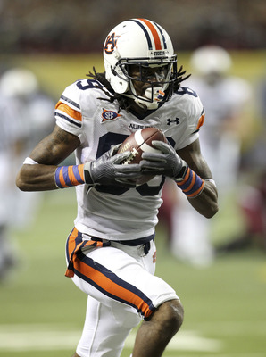 ATLANTA - DECEMBER 4:  Wide receiver Darvin Adams #89 of the Auburn Tigers makes a reception for a touchdown during the 2010 SEC Championship against the South Carolina Gamecocks at Georgia Dome on December 4, 2010 in Atlanta, Georgia. (Photo by Mike Zarr